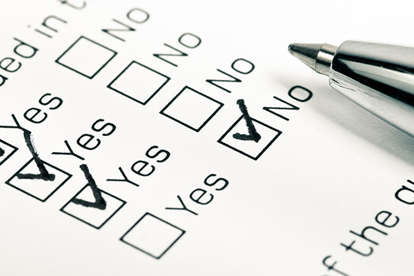 Close up shot of filled check boxes with pen