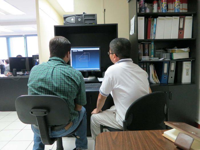 Atlantic_Mario Guzman (rt) training a colleague